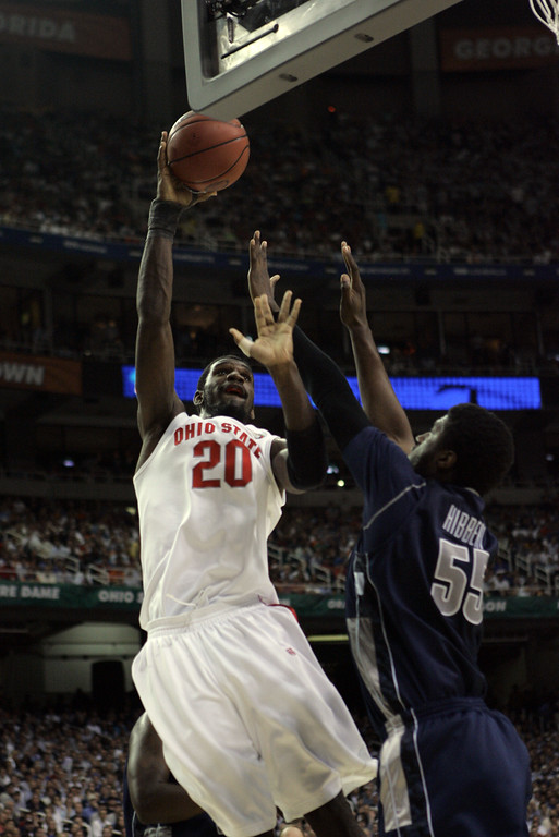 . Ohio State center Greg Oden attempts a fadeaway against Georgetown\'s Roy Hibbert during their men\'s semifinal basketball game at the Final Four in the Georgia Dome in Atlanta Saturday, March 31, 2007. (AP Photo/Gerry Broome)