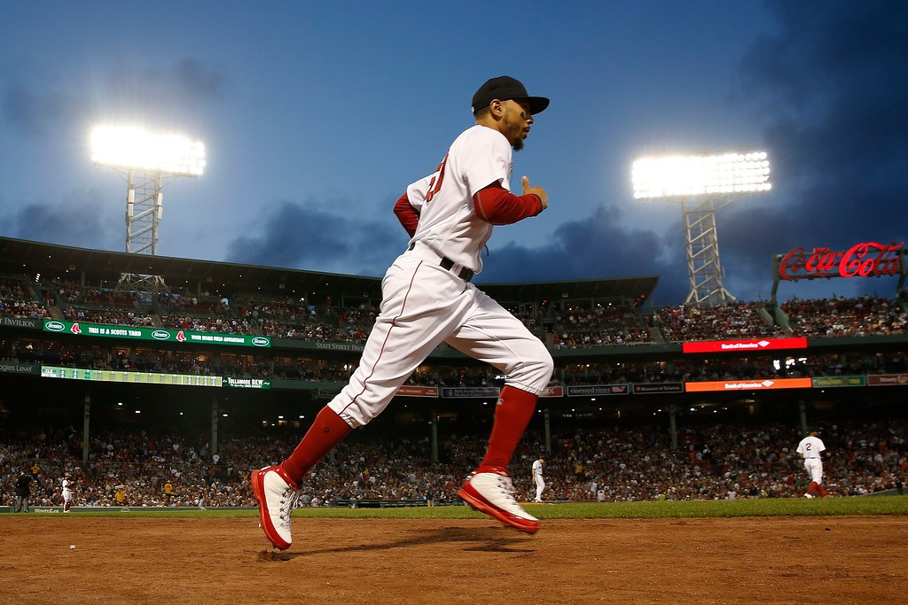 . Boston Red Sox\'s Mookie Betts takes the field during the third inning of a baseball game against the Cleveland Indians in Boston, Tuesday, Aug. 21, 2018. (AP Photo/Michael Dwyer)