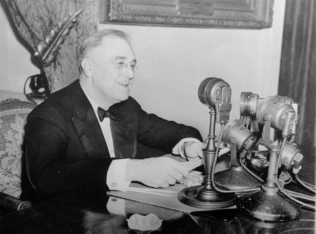 . President Franklin D. Roosevelt talks to the nation in a fireside chat from the White House in this November 1937 photo.  FDR introduced his radio talks to explain administration policies and to appeal to the people for support for them during the difficult 1930\'s.  (AP Photo)