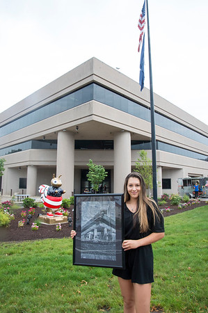 08/13/19 Wesley Bunnell | Staff Deanna Lavoye, a Fine Arts major at UCONN, poses with a drawing she created of 1 Liberty Square.