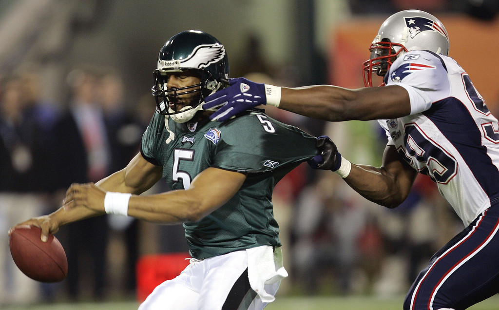 . PHILADELPHIA EAGLES - Philadelphia Eagles quarterback Donovan McNabb (5) tries to escape the grasp of New England Patriots\' Roosevelt Colvin in the first quarter of Super Bowl XXXIX in Jacksonville, Fla., on Sunday, Feb. 6, 2005. (AP Photo/Chris O\'Meara)