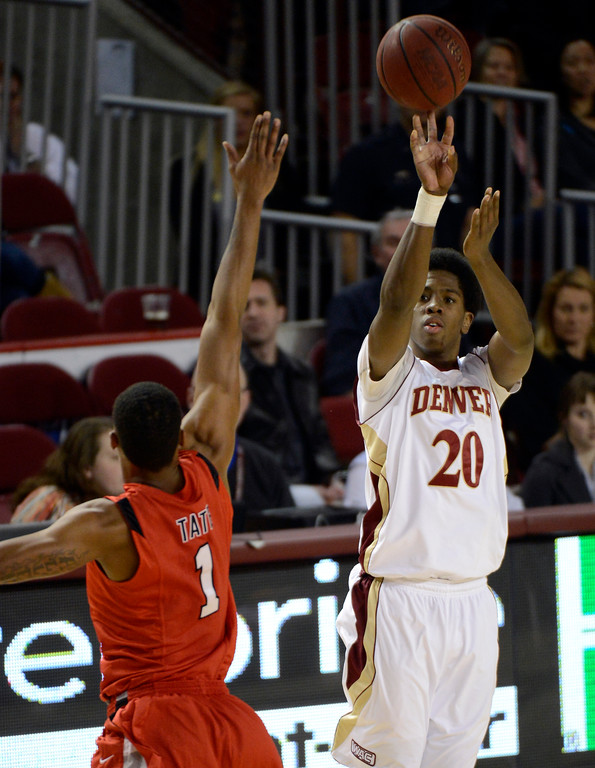 . DENVER, CO. - FEBRUARY 07: Royce O\'Neale (20) of the Denver Pioneers over Allen Tate (1) of the Seattle Redhawks during the second half February 7, 2013 at Magness Arena.The Denver Pioneers defeated the Seattle Redhawks 72-55. (Photo By John Leyba/The Denver Post)