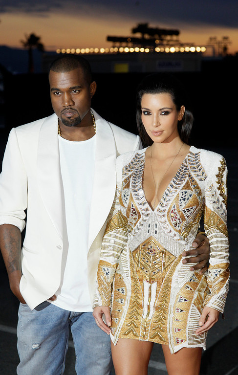 . Singer Kanye West, left, and television personality Kim Kardashian arrive for the screening of Cruel Summer at the 65th international film festival, in Cannes, southern France, Wednesday, May 23, 2012. (AP Photo/Francois Mori)