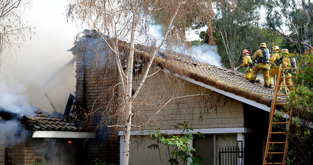 . Los Angeles County Firefighters battle a fire that damaged a single family home. The fire started in the garage along the 1300 block of Via Verde. No injuries, but 5 cars were destroyed including two jaguars in San Dimas, Calif., on Saturday, Jan.4, 2014. 