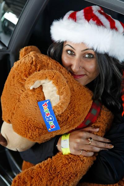 Xtreme Xperience elf Alisha Ahuja holds a donated Teddy Bear. (Bradley S. Pines / Xtreme Xperience)