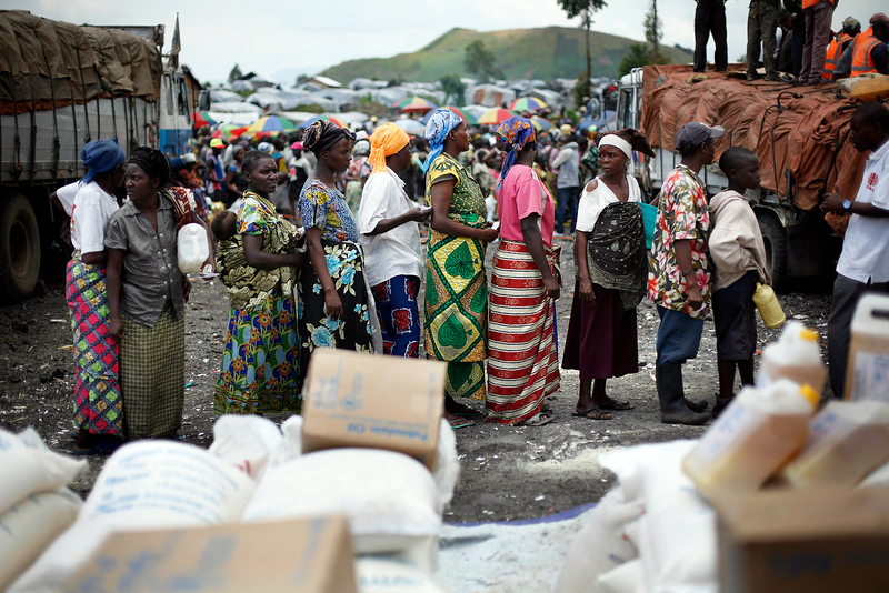 . Internally displaced Congolese women  wait for food to be distributed by WFP at the Mugunga 3 camp outside the eastern Congolese town of Goma Sunday Dec. 2, 2012. Rebels say they will take back Congo\'s city of Goma if the government does not agree to negotiate with them by Monday. The M23 rebels completed their withdrawal of the eastern Congo city on Saturday, in compliance with an agreement reached between the rebel group and a regional body. (AP Photo/Jerome Delay)