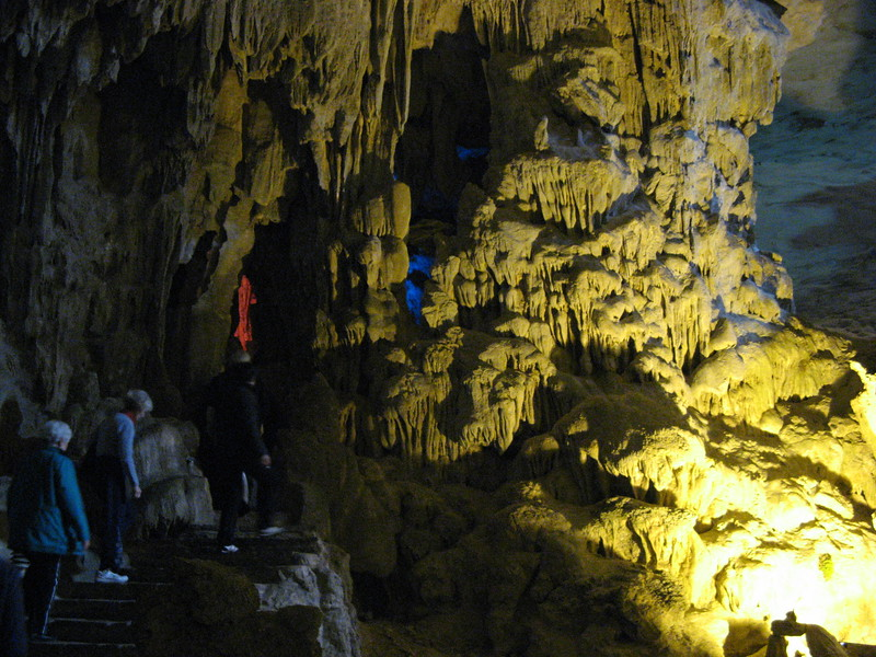 Walking along steps through the Surprise cave.