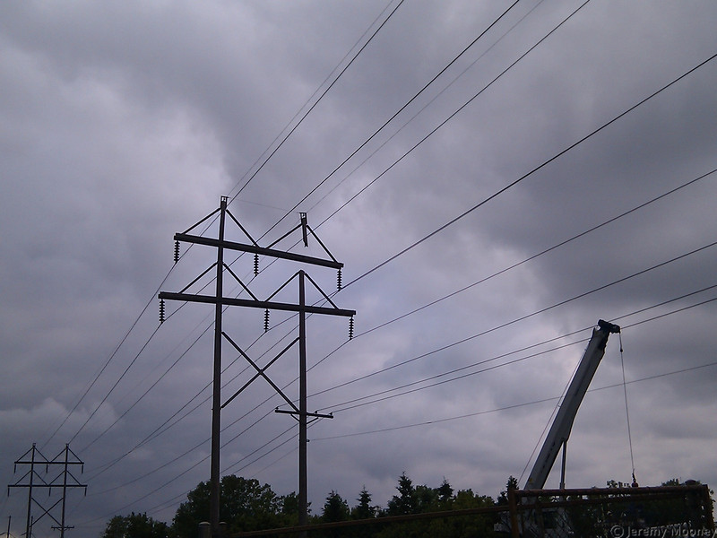 The missing section is near the top of the right pole. Note the left pole is supporting the weight of the crossbar, and bending because of it. The pole is stamped 75ft, and the power company said the crossbars are 30ft and 34ft.