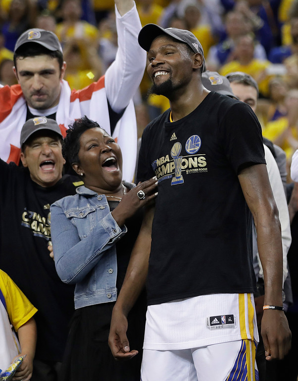 . Golden State Warriors forward Kevin Durant, right, celebrates with his mother Wanda Durant as he is named the NBA Finals Most Valuable Player after Game 5 of basketball\'s NBA Finals between the Warriors and the Cleveland Cavaliers in Oakland, Calif., Monday, June 12, 2017. The Warriors won 129-120 to win the NBA championship. (AP Photo/Marcio Jose Sanchez)