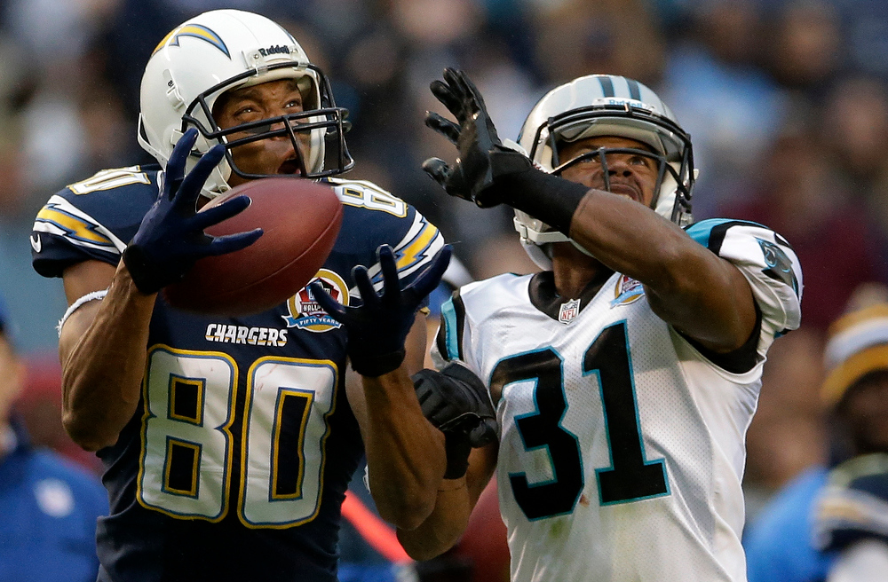 Description of . San Diego Chargers wides receiver Malcolm Floyd, left, hauls in a pass as Carolina Panthers cornerback James Dockery defends during the second half of an NFL football game Sunday, Dec. 16, 2012, in San Diego. (AP Photo/Gregory Bull)