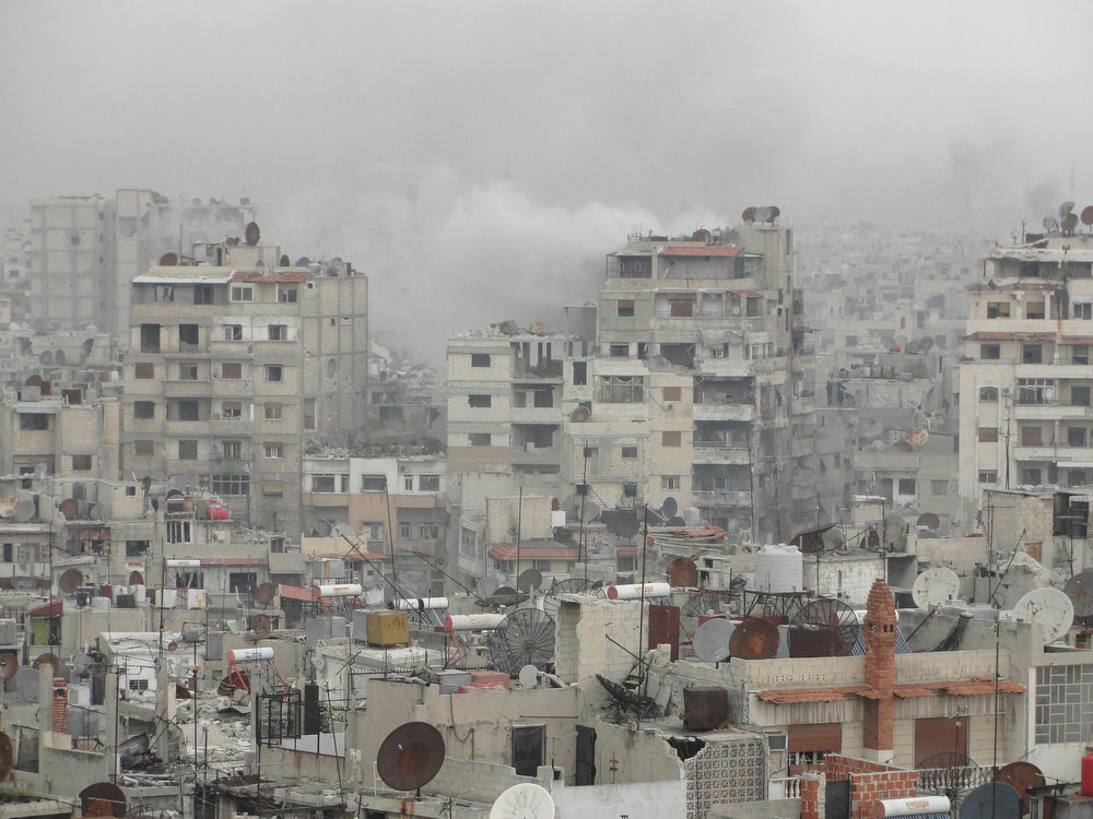 . Smoke rises after what activists said was shelling by forces loyal to Syria\'s President Bashar al-Assad in the old city of Homs March 22, 2013. Picture taken March 22, 2013. REUTERS/Mohamed Ibrahim/Shaam News Network/Handout