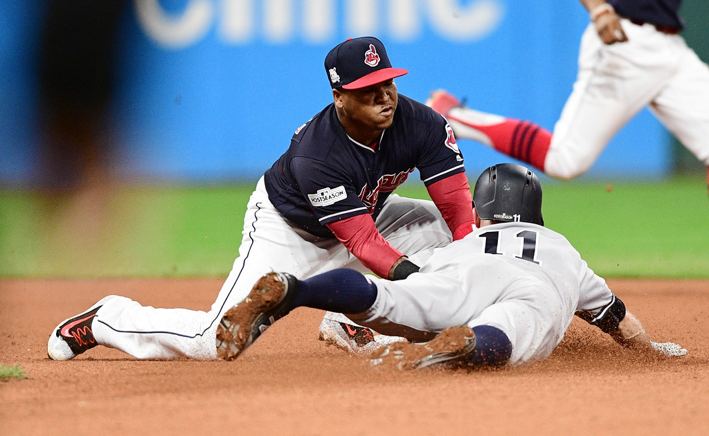 . Cleveland Indians\' Jose Ramirez, left, tags out New York Yankees\' Brett Gardner as Gardner tried to steal second base during the seventh inning of Game 5 of a baseball American League Division Series, Wednesday, Oct. 11, 2017, in Cleveland. (AP Photo/David Dermer)