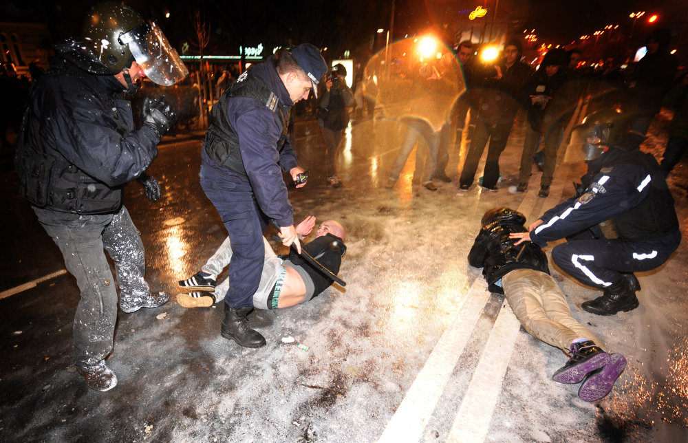 Description of . Riot police clash with demonstrators during a protest against the government in downtown Sofia on February 19, 2013. Bulgaria has been shaken over the past week by protests that initially were about soaring electricity prices but which have turned into demonstrations against the government in general.   NIKOLAY DOYCHINOV/AFP/Getty Images