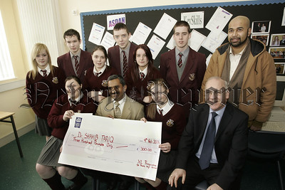 XL Programme, students at St Pauls High School non uniform day raises £300 tor the Packistanian Earthquake Fund, Pictured Dr Shahib Tariq, (Consultant Daisy Hill Hospital) receiving the cheque, also in picture Mr Oliver Mooney, (Principle).06W7N1