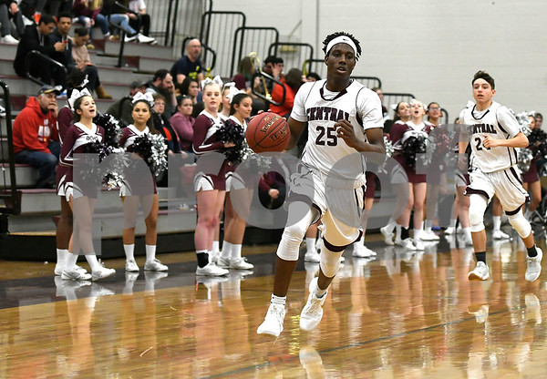 2/1/2018 Mike Orazzi | Staff Bristol Central's Jaekwon Spencer (25) during Thursday night's boys basketball game with Platt at BC.