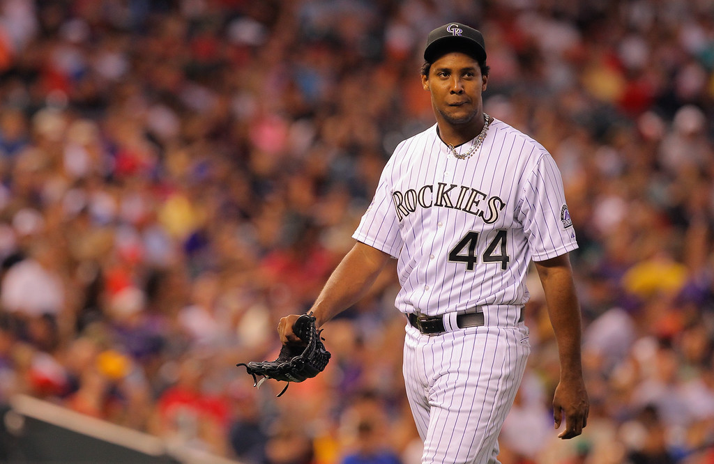 . DENVER, CO - JUNE 14:  Starting pitcher Juan Nicasio #44 of the Colorado Rockies is removed from the game against the Philadelphia Phillies in the sixth inning at Coors Field on June 14, 2013 in Denver, Colorado.  (Photo by Doug Pensinger/Getty Images)