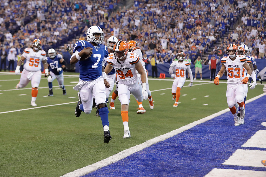 . Indianapolis Colts quarterback Jacoby Brissett (7) runs in for a touchdown in front of Cleveland Browns defensive end Carl Nassib (94) during the first half of an NFL football game in Indianapolis, Sunday, Sept. 24, 2017. (AP Photo/Darron Cummings)