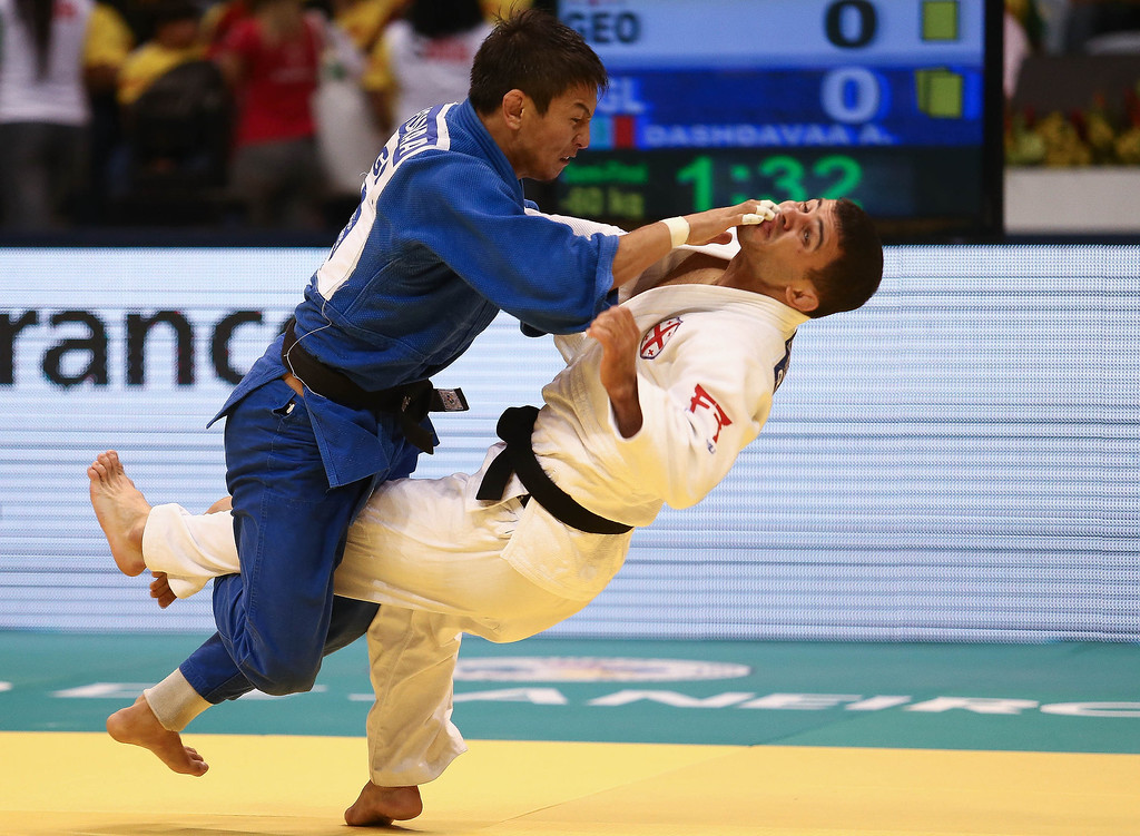 . RIO DE JANEIRO, BRAZIL - AUGUST 26:  Amartuvshin Dashdavaa (blue) of Mongolia fights against Amiran Papinashvili of Georgia in the -60 kg category during the World Judo Championships at the Maracanazinho gymnasium on August 26, 2013 in Rio de Janeiro, Brazil.(Photo by Buda Mendes/Getty Images)