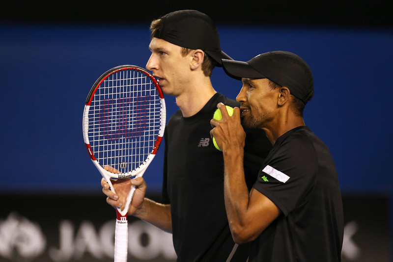 . Eric Butorac (L) of the United States and Raven Klaasen of South Africa talk tactics in their Men\'s Doubles Final against Lukasz Kubot of Poland and Robert Lindstedt of Sweden during day 13 of the 2014 Australian Open at Melbourne Park on January 25, 2014 in Melbourne, Australia.  (Photo by Michael Dodge/Getty Images)