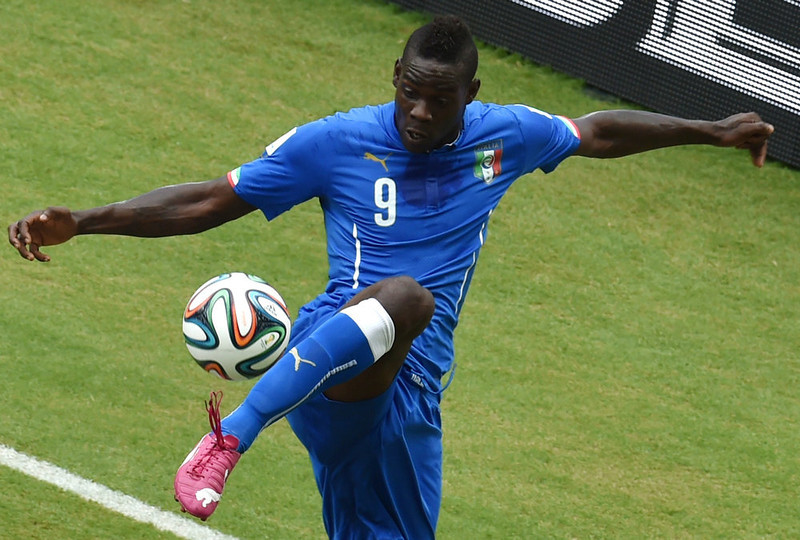 . Italy\'s forward Mario Balotelli controls the ball during a Group D football match between Italy and Uruguay at the Dunas Arena in Natal during the 2014 FIFA World Cup on June 24, 2014.  YASUYOSHI CHIBA/AFP/Getty Images