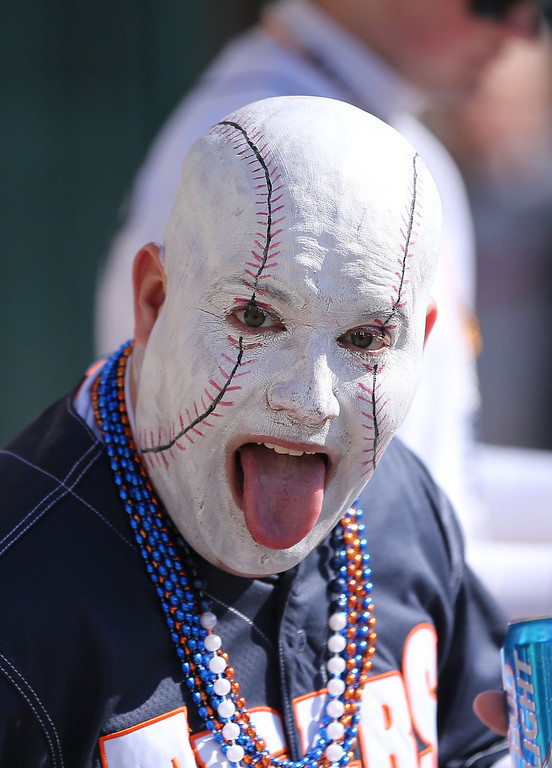 . A fan with face paint poses on Opening Day and the game between the Kansas City Royals and the Detroit Tigers at Comerica Park on March 31, 2014 in Detroit, Michigan.  (Photo by Leon Halip/Getty Images)