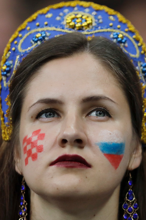 . A fan with the Croatian and Russian colors painted on her face after the final match between France and Croatia at the 2018 soccer World Cup in the Luzhniki Stadium in Moscow, Russia, Sunday, July 15, 2018. (AP Photo/Natacha Pisarenko)