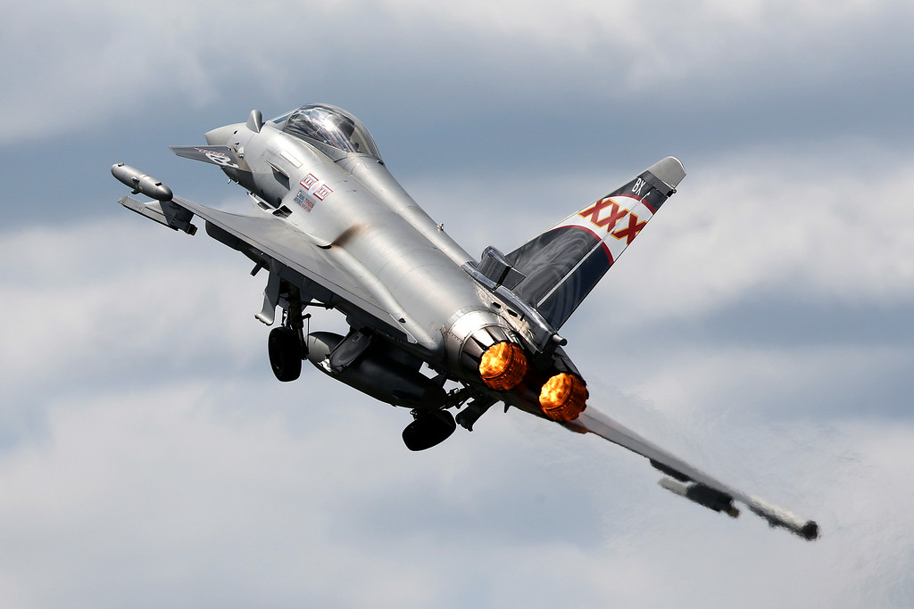 . A Eurofighter Typhoon takes off for a flying display during Farnborough International Air Show, Farnborough, England, Monday, July 14, 2014. (AP Photo/Sang Tan)