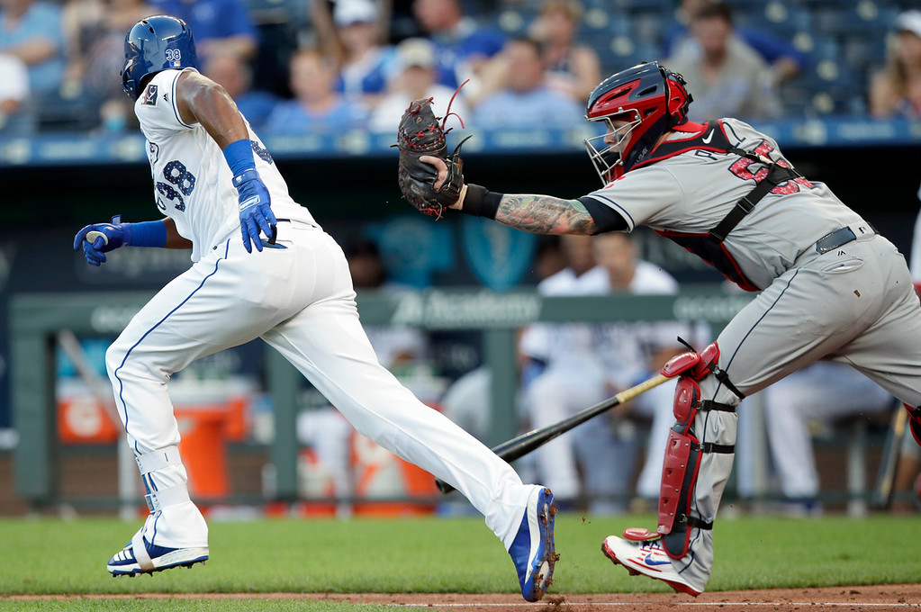 . Cleveland Indians catcher Roberto Perez (55) tries to tag out Kansas City Royals\' Jorge Bonifacio (38) after a dropped third strike during the second inning of a baseball game at Kauffman Stadium in Kansas City, Mo., Wednesday, July 4, 2018. Bonifacio was thrown out at first base. (AP Photo/Orlin Wagner)