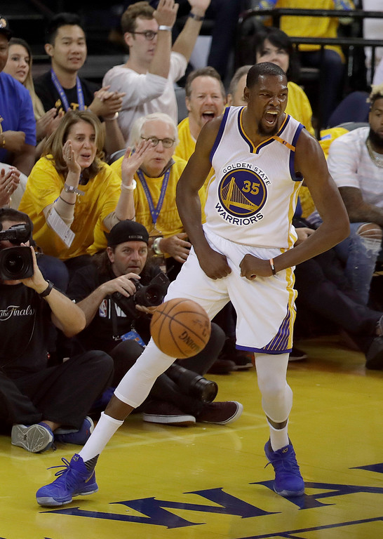 . Golden State Warriors forward Kevin Durant (35) celebrates after scoring against the Cleveland Cavaliers during the second half of Game 2 of basketball\'s NBA Finals in Oakland, Calif., Sunday, June 4, 2017. (AP Photo/Marcio Jose Sanchez)