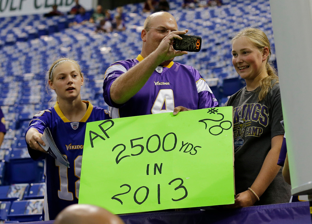 . Vikings fans show their support for running back Adrian Peterson look on before Minnesota\'s game against the Titans. (AP Photo/Ann Heisenfelt)