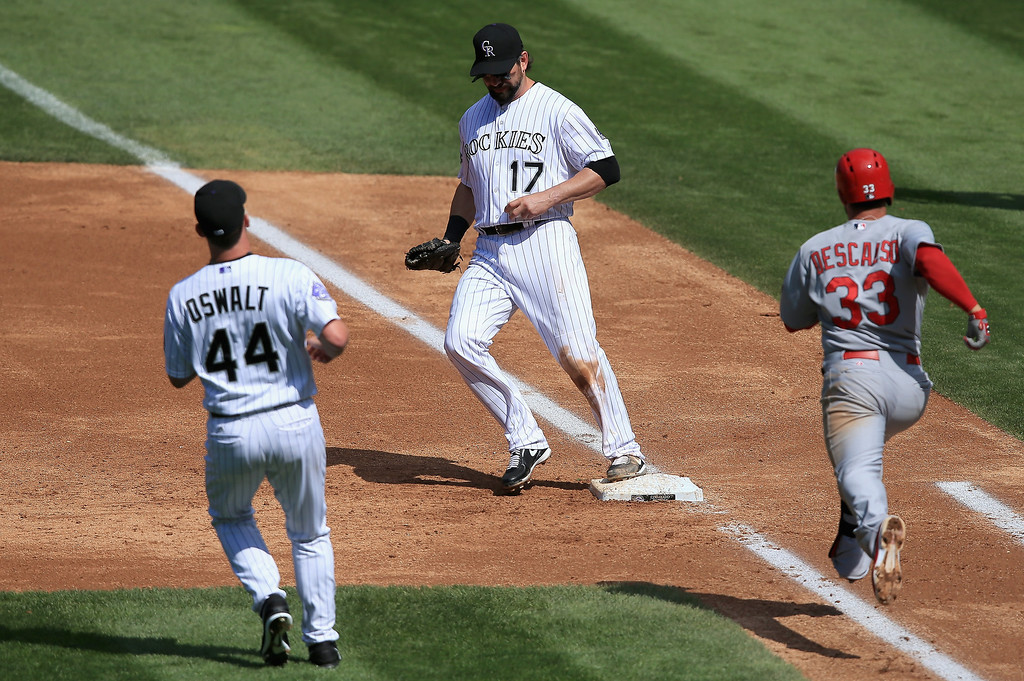 . First baseman Todd Helton #17 of the Colorado Rockies gets an unassisted put out on a ground ball by Daniel Descalso #33 of the St. Louis Cardinals at Coors Field on September 19, 2013 in Denver, Colorado.  (Photo by Doug Pensinger/Getty Images)