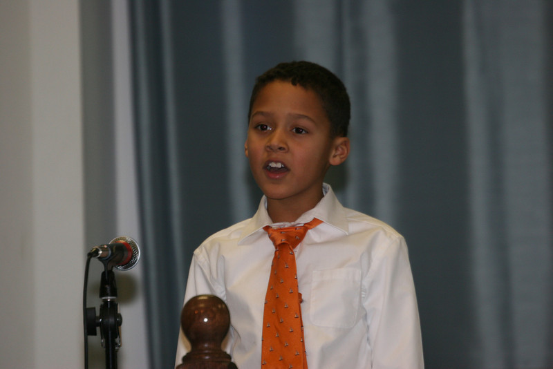 Edward participating in a skit during the Christmas Program