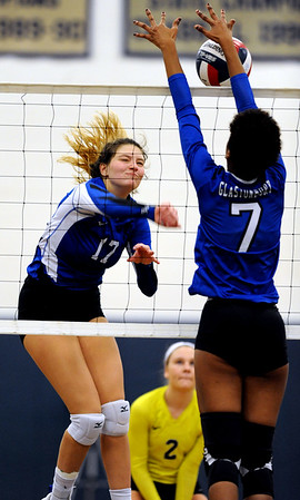 10/30/2018 Mike Orazzi   Staff Bristol Eastern's Gabriella Nozzolillo (17) with Glastonbury's Gabrielle Johnson (7) during the CCC volleyball tournament at Eastern Tuesday.
