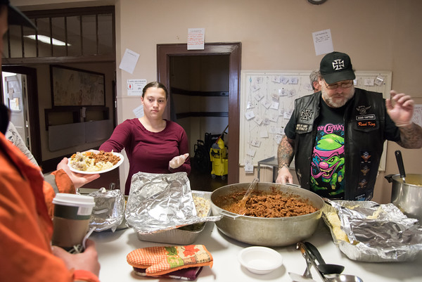 04/06/18 Wesley Bunnell | Staff Andrianna Baez , L, volunteers to serve the hungry at St. Mark's Church alongside of Bernie Boucher on Friday evening. The church which is located on W. Main St in New Britain holds a feed the hungry dinner every Friday from 5-6pm for approximately 70-100 individuals relying in large part to donations from the community.