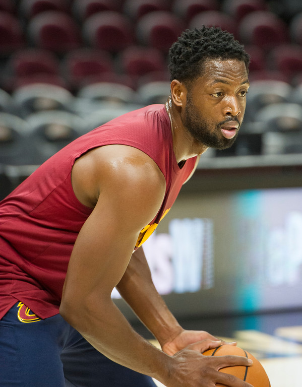 . Cleveland Cavaliers\' Dwayne Wade warms up before playing an NBA pre-season basketball game against the Chicago Bulls in Cleveland, Tuesday, Oct. 10, 2017. (AP Photo/Phil Long)