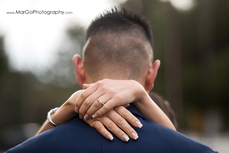 wedding rings on groom's neck at train station near Sunol's Casa Bella