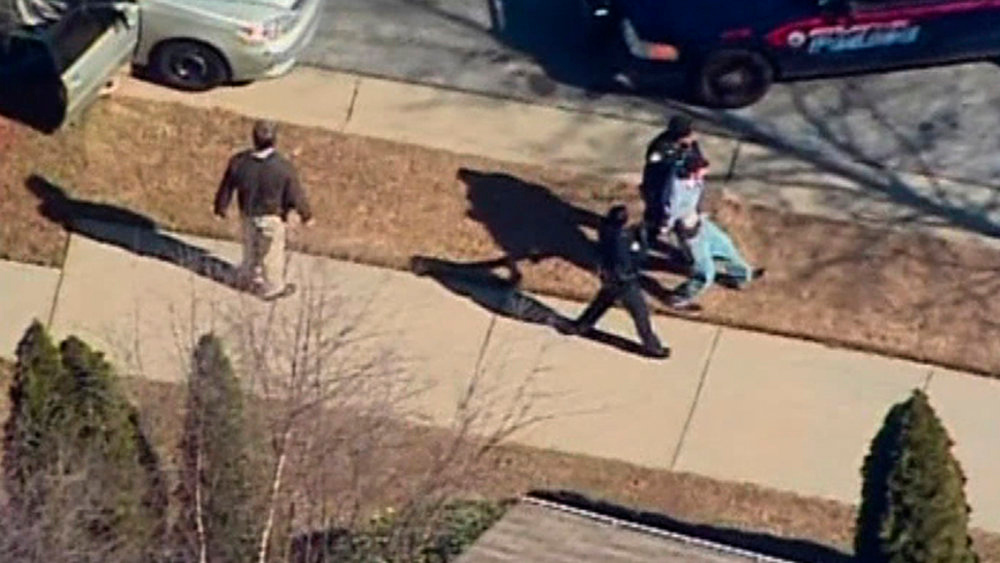 Description of . A male suspect is escorted to a police cruiser in this still image taken from video at Price Middle School in Atlanta, Georgia January 31, 2013.  A 14-year old student was wounded on Thursday in a shooting outside the school according to police reports.  REUTERS/WXIA-TV/NBC/Handout