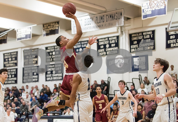 f03/12/18 Wesley Bunnell | Staff New Britain basketball vs Immaculate at Immaculate High School on Monday night. Kaiyon Gunn (55).