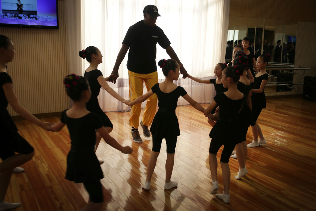 . Former NBA basketball star Dennis Rodman dances with school children at the Mangyongdae School Children\'s Palace on Thursday, June 15, 2017, in Pyongyang, North Korea. (AP Photo/Kim Kwang Hyon)