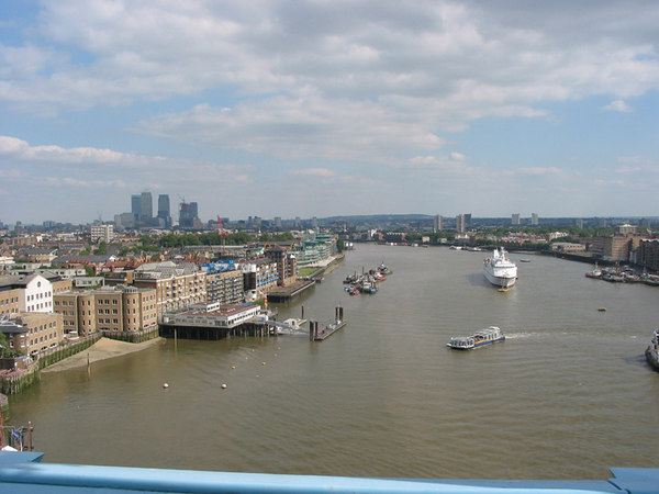 View from the top of Tower Bridge down the Thames towards Dockland and Canary Wharf.