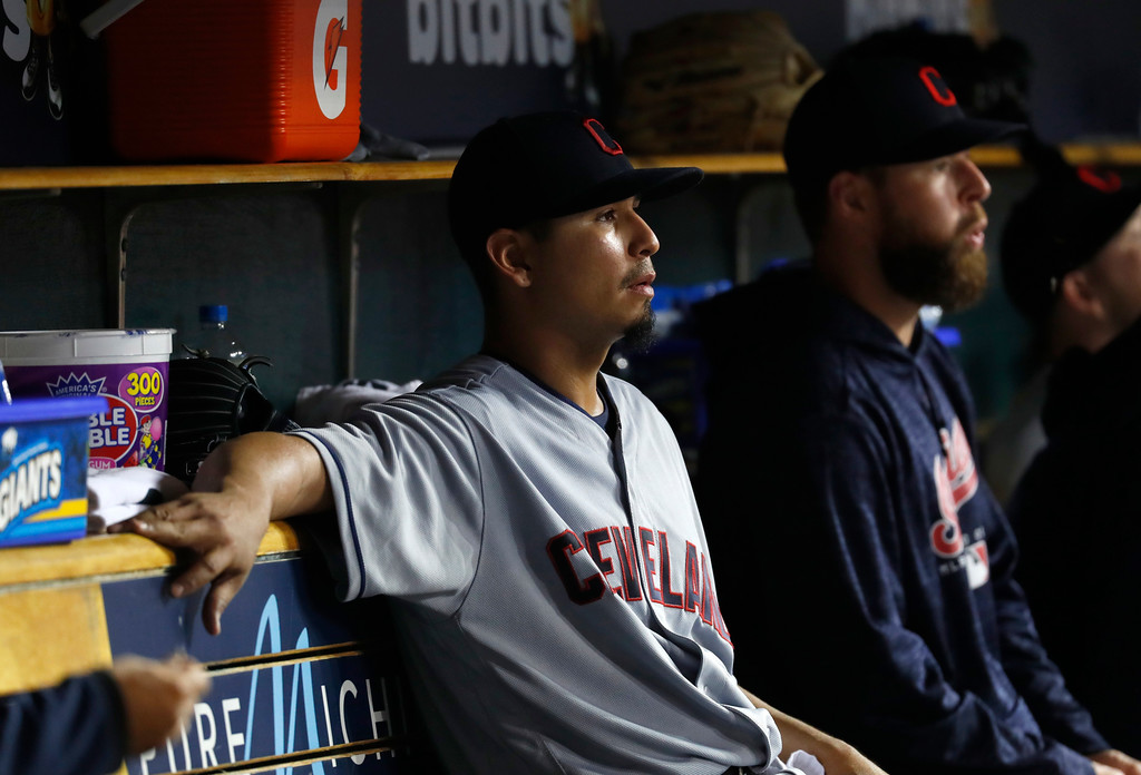 . Cleveland Indians pitcher Carlos Carrasco watches from the dugout against the Detroit Tigers in the seventh inning of a baseball game in Detroit, Monday, May 14, 2018. (AP Photo/Paul Sancya)