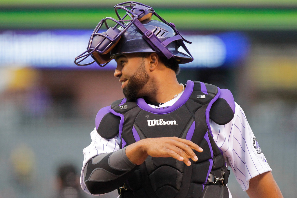 . Colorado Rockies\' Wilin Rosario looks at the San Francisco Giants bench before the start of the baseball game, Tuesday, April 22, 2014, in Denver. (AP Photo/Barry Gutierrez)