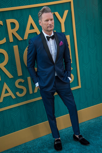HOLLYWOOD, CA - AUGUST 07: Brian Tyler arrives at Warner Bros. Pictures' 'Crazy Rich Asians' Premiere at TCL Chinese Theatre IMAX on Tuesday, August 7, 2018 in Hollywood, California. (Photo by Tom Sorensen/Moovieboy Pictures)
