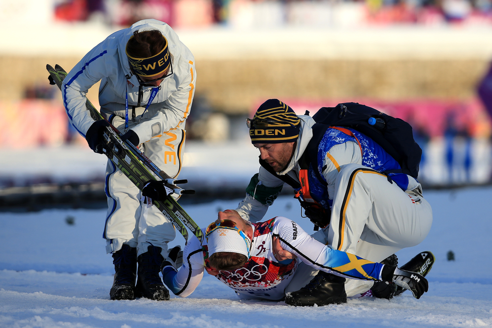 . Emil Joensson of Sweden is tended to in the Finals of the Men\'s Sprint Free during day four of the Sochi 2014 Winter Olympics at Laura Cross-country Ski & Biathlon Center on February 11, 2014 in Sochi, Russia.  (Photo by Richard Heathcote/Getty Images)