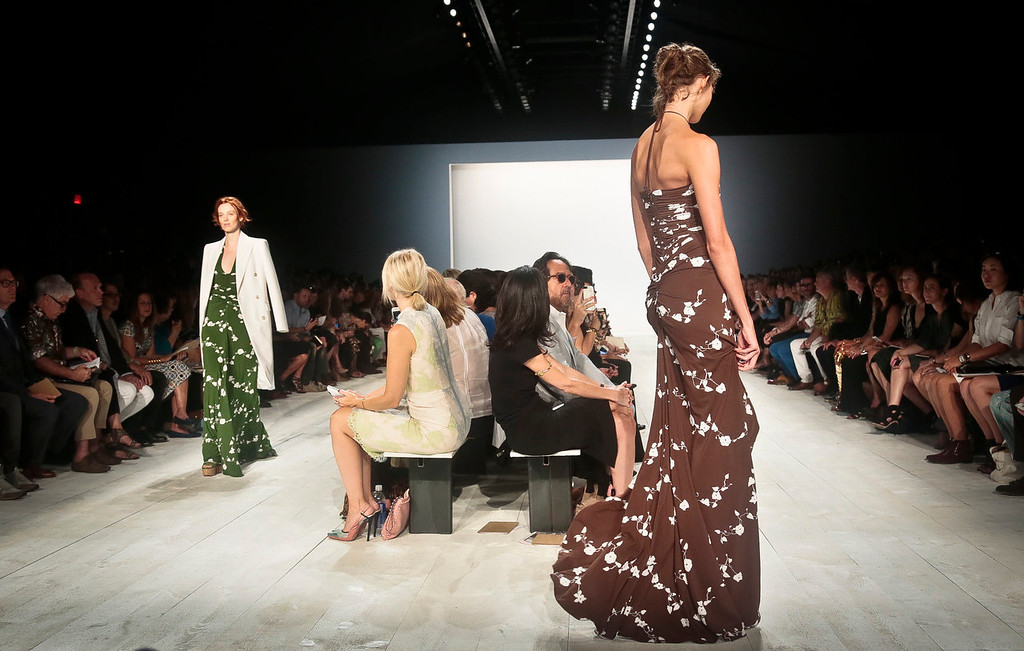 . Fashion from the Michael Kors Spring 2014 collection is modeled on Wednesday, Sept. 11, 2013 in New York.  (AP Photo/Bebeto Matthews)