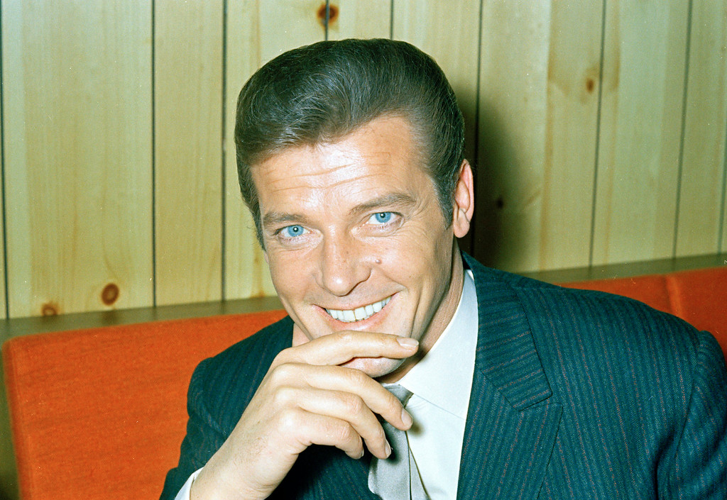 """. FILE - This is a May 1968 file photo of British actor Roger Moore of \""""The Saint\""""  and James Bond fame. Roger Moore\'s family said Tuesday May 23, 2017 that the  former James Bond star has died after a short battle with cancer  (AP Photo/ File)"""