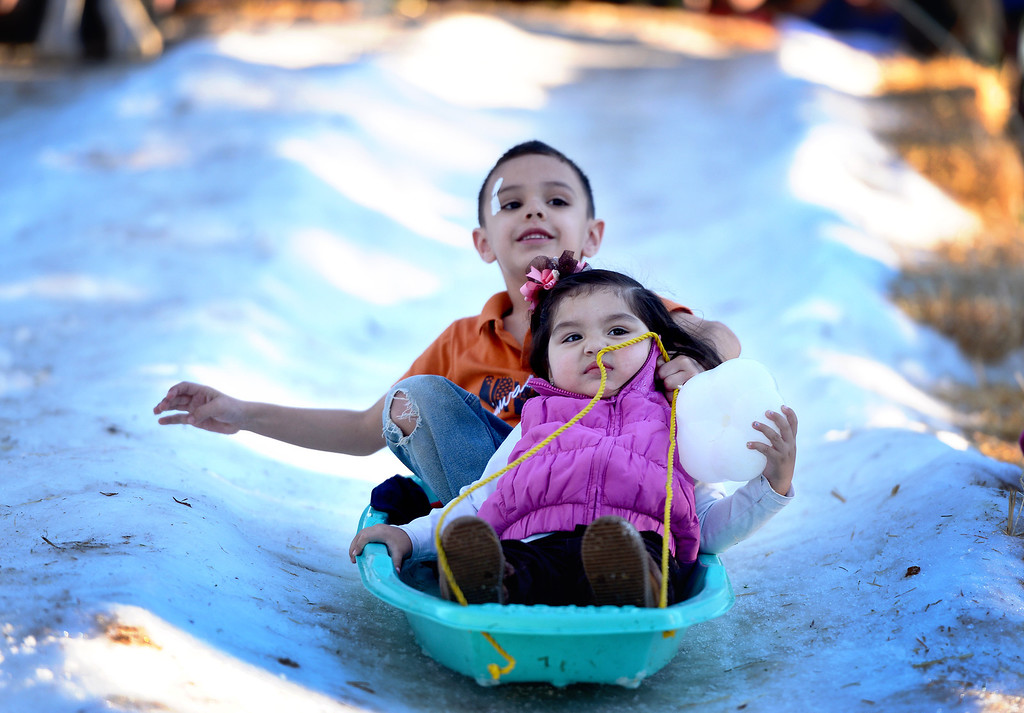 . Max Cuevas, 6, of Los Angeles, and his cousin Jaileen Avalos, 1, go sledding during Montebello\'s annual Winter Wonderland at Montebello City Park Saturday, December 14, 2013. (Photo by Sarah Reingewirtz/Pasadena Star-News)