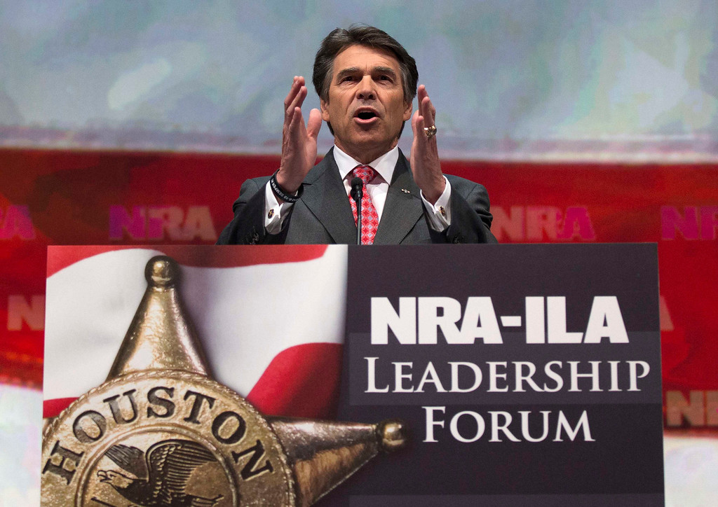 . Texas Governor Rick Perry speaks at the NRA-ILA Leadership Forum at the George R. Brown Convention Center, the site for the National Rifle Association\'s annual meeting in Houston, Texas on May 3, 2013. It is time to stop demonizing all law-abiding gun owners because of violent acts committed by a few criminals, National Rifle Association leaders and political allies said on Friday at its first convention since the Connecticut school massacre. Organizers expect some 70,000 attendees at the 142nd NRA Annual Meetings & Exhibits in Houston, which began on Friday and continues through Sunday. REUTERS/Adrees Latif (UNITED STATES - Tags: POLITICS)