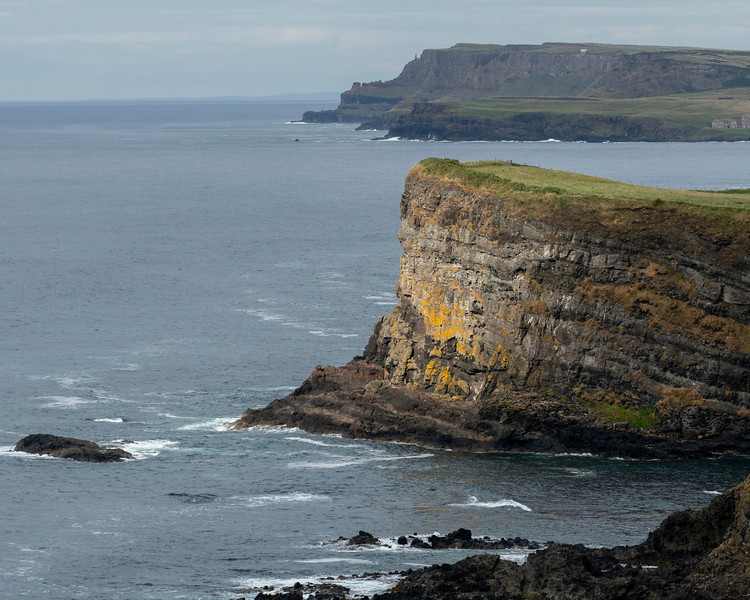 Eroded cliffs by Atlantic Ocean on Causeway Coastal Route, Northern Ireland, Ireland