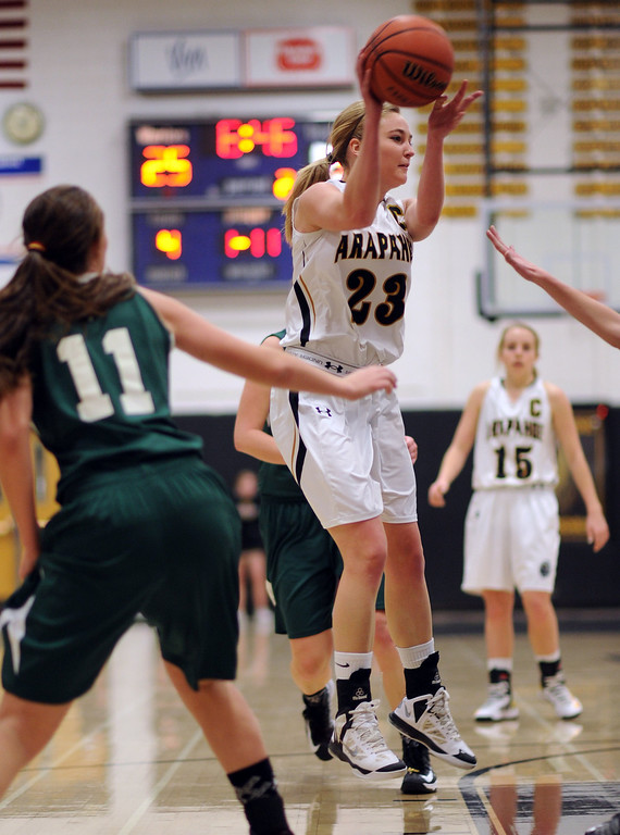 . Arapahoe\'s Stacie Lukasiewicz (23), right, controls the ball by Mountain Vista\'s Paige Keller in the first half of the game at Arapahoe High School Gym onSaturday, Jan. 5, 2013, in Centennial, Colo. Arapahoe won 74-38. Hyoung Chang, The Denver Post